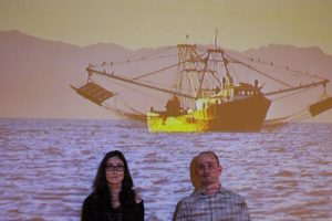 Bycatch_exhibit_photo_Johnson_Magrane_in_front_of_Trawler_video